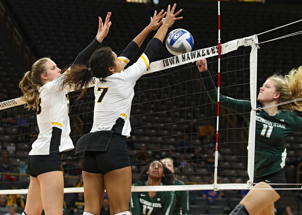 Iowa's Brie Orr (7) blocks a shot as Hannah Clayton (18) looks on during the third set of their volleyball match at Carver-Hawkeye Arena in Iowa City on Sunday, Oct 13, 2019. (Stephen Mally/hawkeyesports.com)