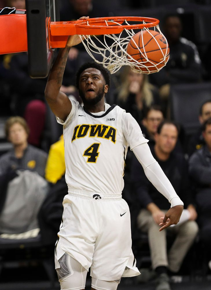 Iowa Hawkeyes guard Isaiah Moss (4) dunks the ball during a game against Guilford College at Carver-Hawkeye Arena on November 4, 2018. (Tork Mason/hawkeyesports.com)