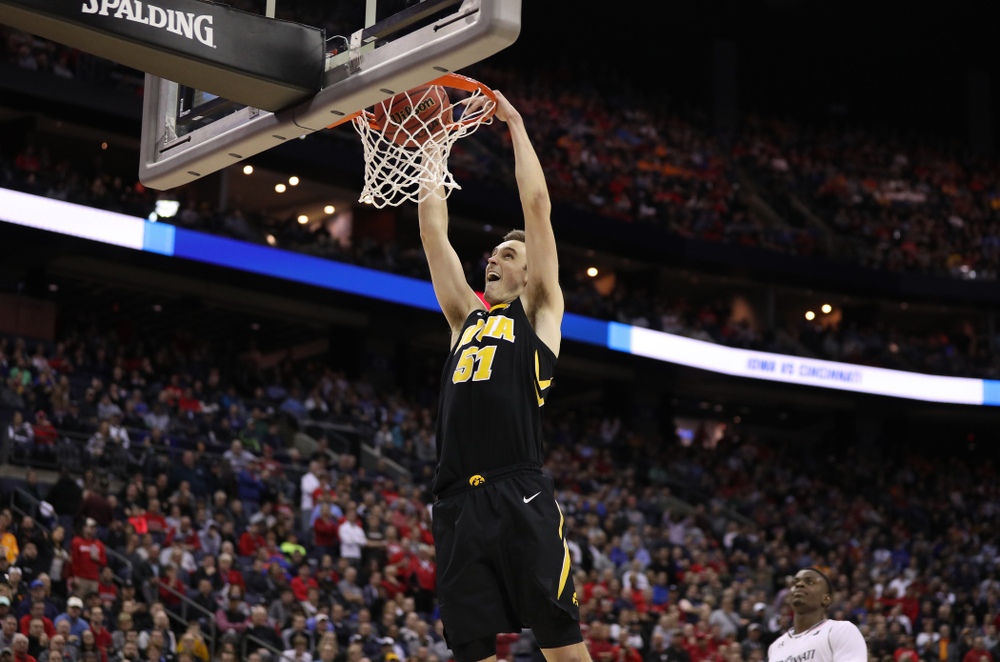 Iowa Hawkeyes forward Nicholas Baer (51) dunks the ball against the Cincinnati Bearcats in the first round of the 2019 NCAA Men's Basketball Tournament Friday, March 22, 2019 at Nationwide Arena in Columbus, Ohio. (Brian Ray/hawkeyesports.com)