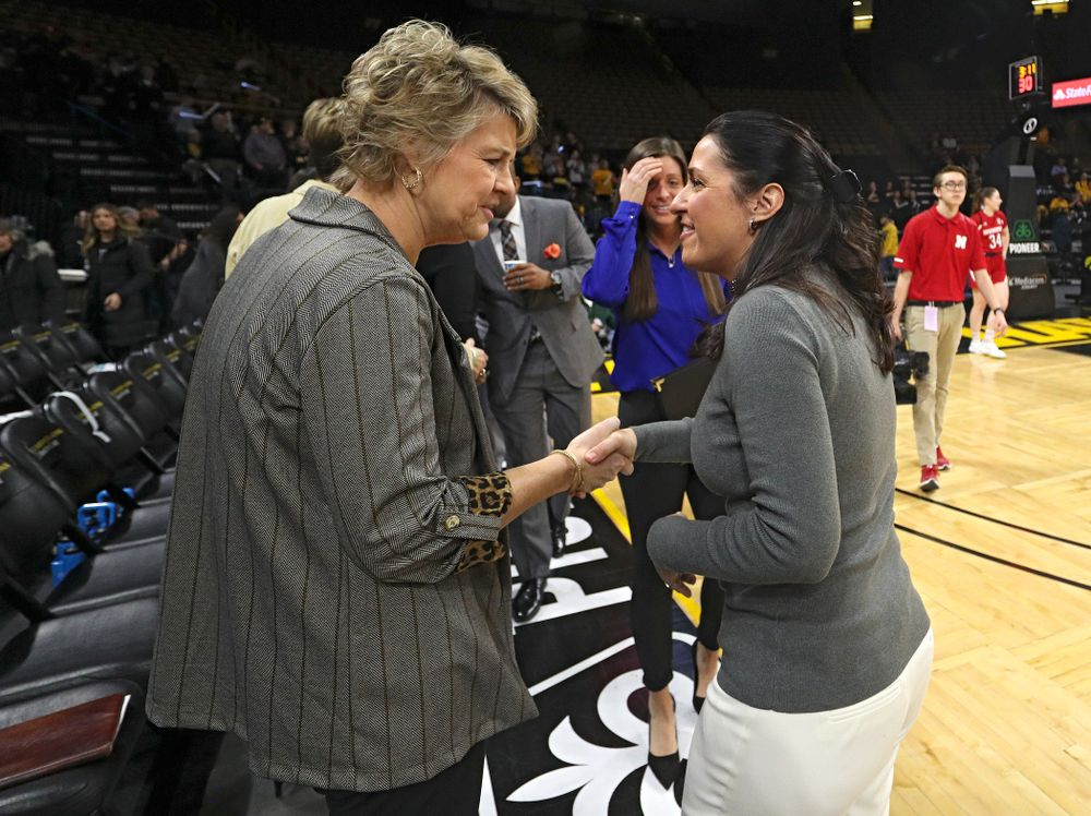 Iowa Hawkeyes head coach Lisa Bluder talks with Nebraska Cornhuskers head coach Amy William before the game at Carver-Hawkeye Arena in Iowa City on Thursday, February 6, 2020. (Stephen Mally/hawkeyesports.com)