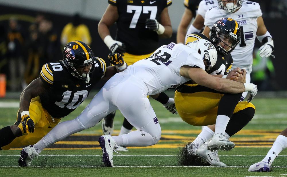 Iowa Hawkeyes quarterback Nate Stanley (4) slides during a game against Northwestern at Kinnick Stadium on November 10, 2018. (Tork Mason/hawkeyesports.com)