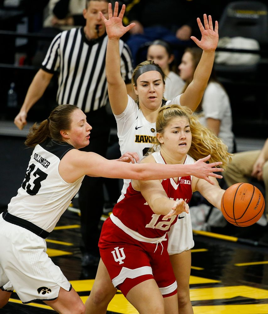 Iowa Hawkeyes forward Amanda Ollinger (43), Iowa Hawkeyes forward Hannah Stewart (21)