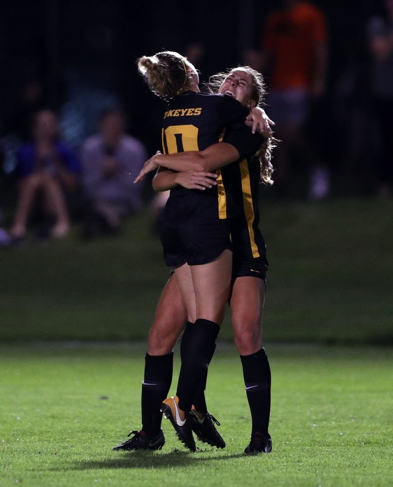 Iowa Hawkeyes midfielder/defender Natalie Winters (10) hugs forward Kaleigh Haus (4) after scoring during a 2-1 victory over the Iowa State Cyclones Thursday, August 29, 2019 in the Iowa Corn Cy-Hawk series at the Iowa Soccer Complex. (Brian Ray/hawkeyesports.com)
