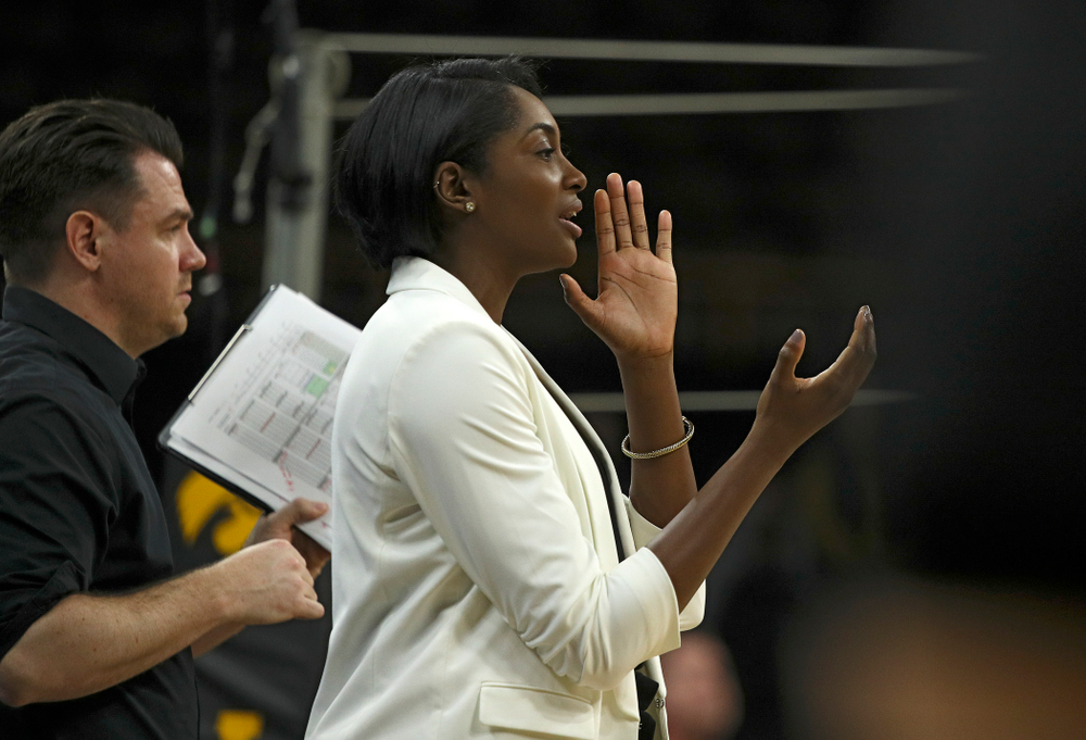 Iowa head coach Vicki Brown (right) shouts to her team as assistant coach Bobby Hughes looks on during the fourth set of their match at Carver-Hawkeye Arena in Iowa City on Saturday, Nov 30, 2019. (Stephen Mally/hawkeyesports.com)