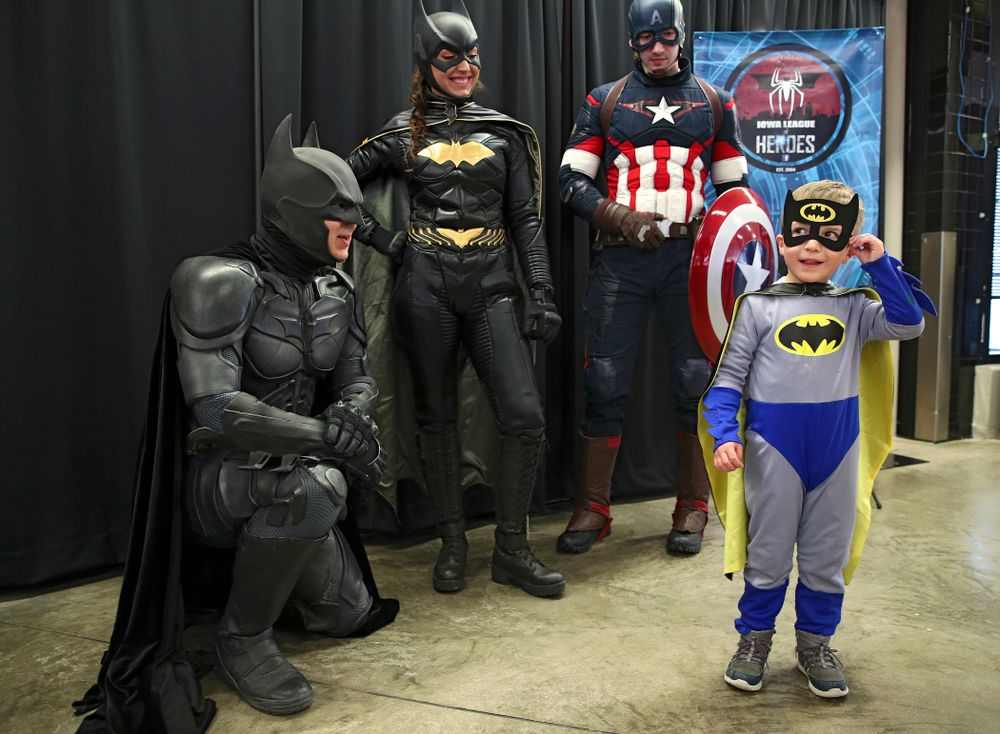 A young fan dressed up as Batman talks with Batman on Superhero and Princess Day before the meet at Carver-Hawkeye Arena in Iowa City on Sunday, March 8, 2020. (Stephen Mally/hawkeyesports.com)