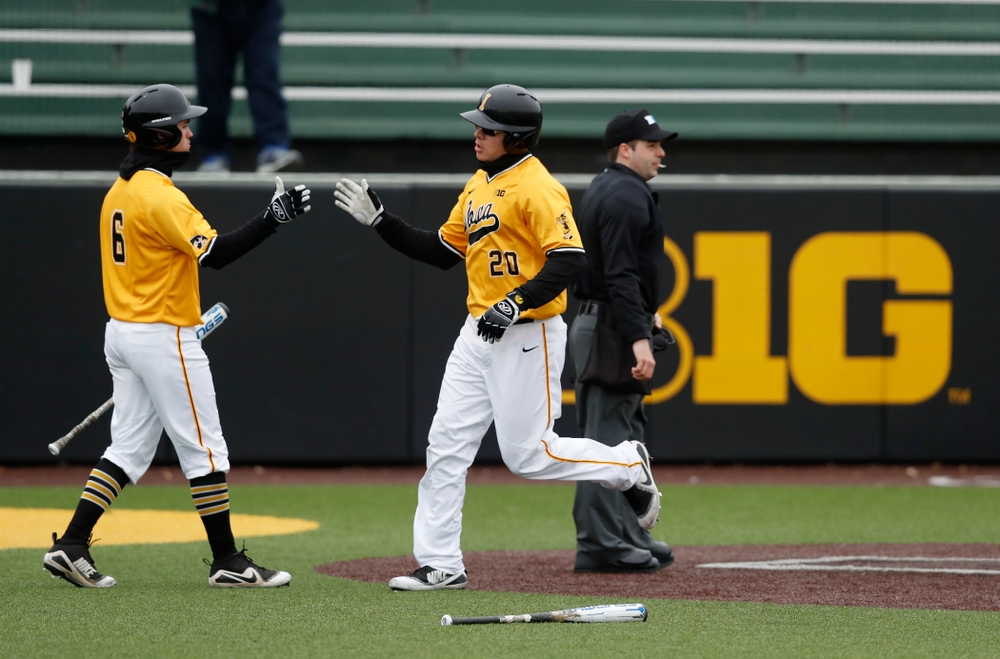 Iowa Hawkeyes catcher Austin Guzzo (20) and outfielder Justin Jenkins (6) against the Ohio State Buckeyes Sunday, April 8, 2018 at Duane Banks Field.(Brian Ray/hawkeyesports.com)