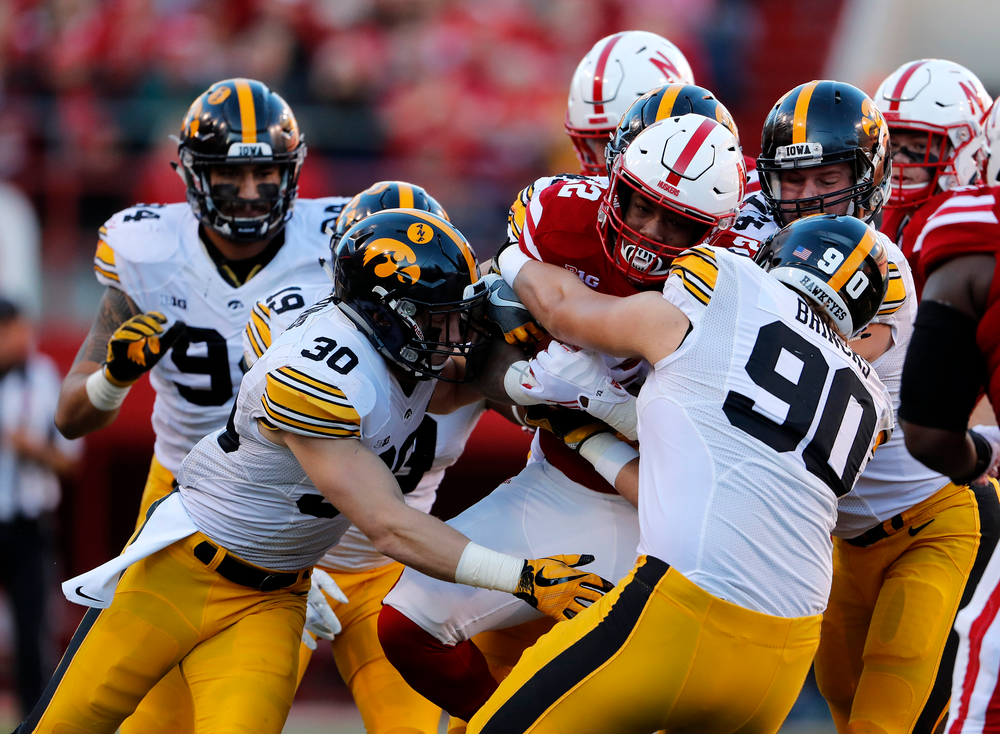 Iowa Hawkeyes defensive back Jake Gervase (30) and defensive end Sam Brincks (90)