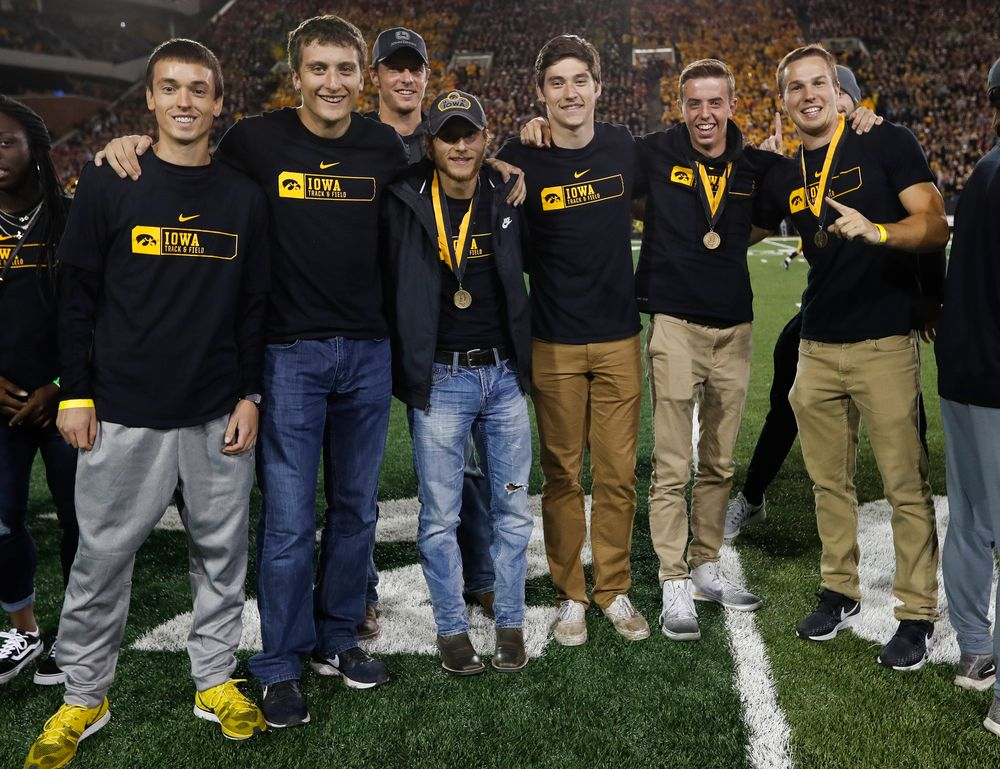 Members of the Iowa men's track and field team are recognized by the Presidential Committee on Athletics at halftime during a game against Wisconsin on September 22, 2018. (Tork Mason/hawkeyesports.com)