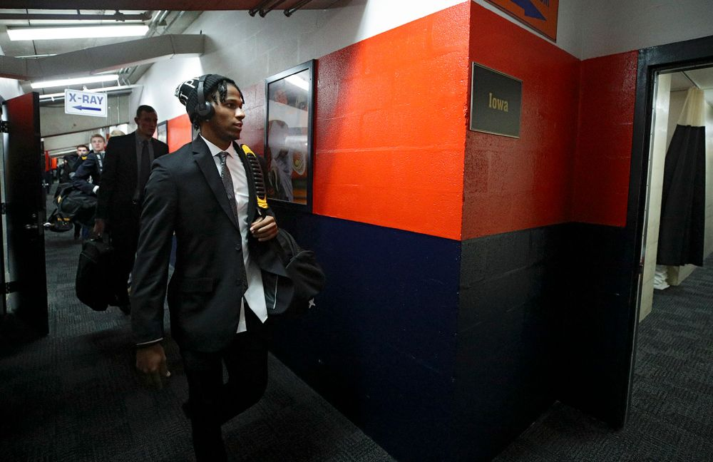 Iowa Hawkeyes guard Bakari Evelyn (4) walks to the locker room as the team arrives before their ACC/Big Ten Challenge game at the Carrier Dome in Syracuse, N.Y. on Tuesday, Dec 3, 2019. (Stephen Mally/hawkeyesports.com)