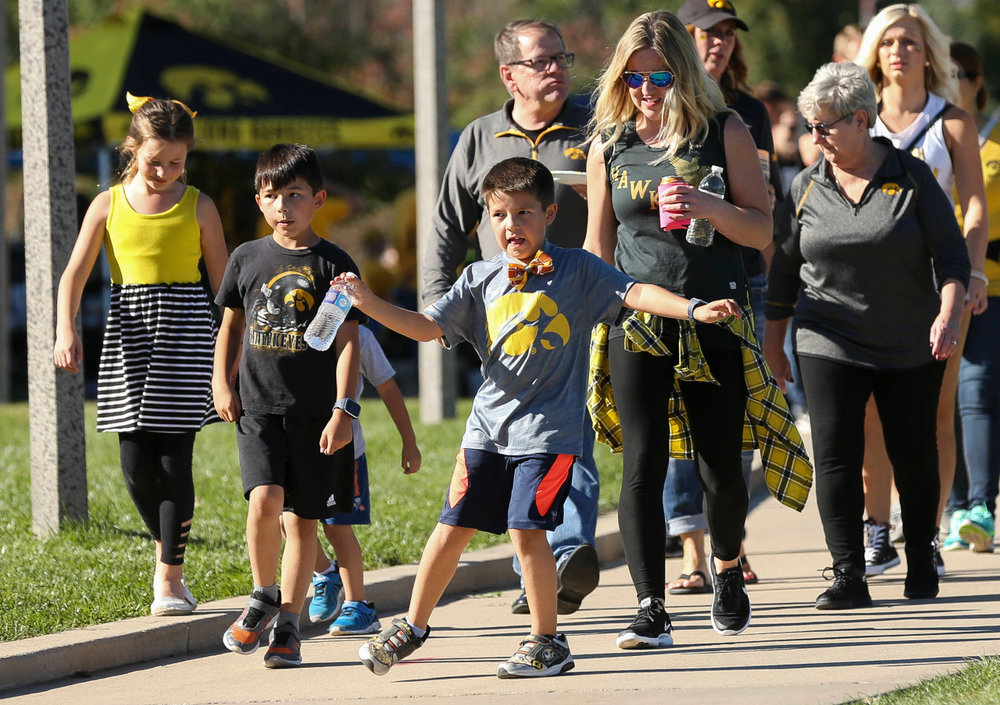 Fans make their way toward Kinnick Stadium before a game against Wisconsin on September 22, 2018.