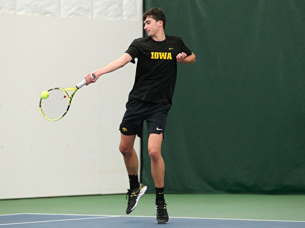 Iowa's Matt Clegg returns a shot during his doubles match at the Hawkeye Tennis and Recreation Complex in Iowa City on Friday, February 14, 2020. (Stephen Mally/hawkeyesports.com)