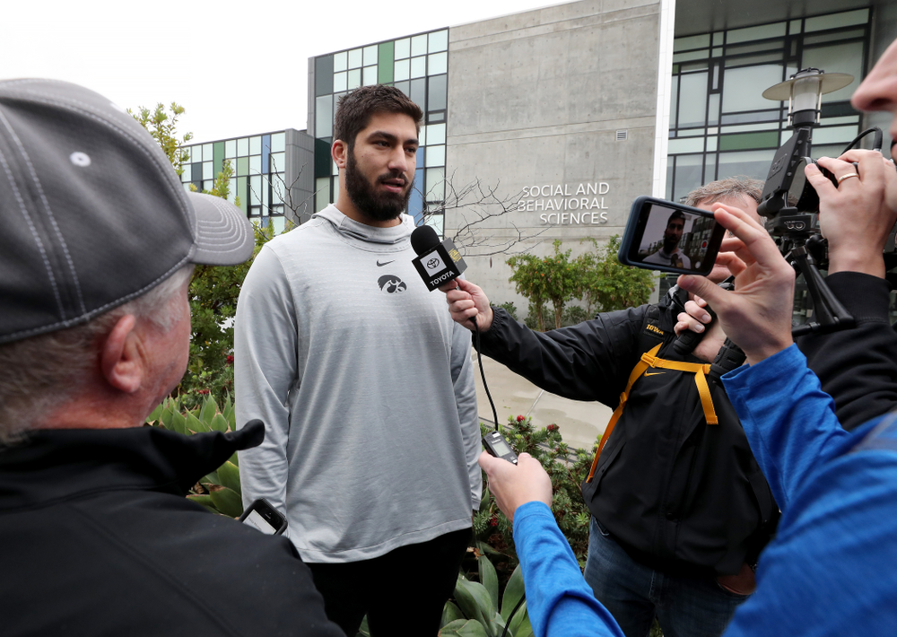 Iowa Hawkeyes defensive end A.J. Epenesa (94) answers questions from the media following practice Monday, December 23, 2019 at Mesa College in San Diego. (Brian Ray/hawkeyesports.com)