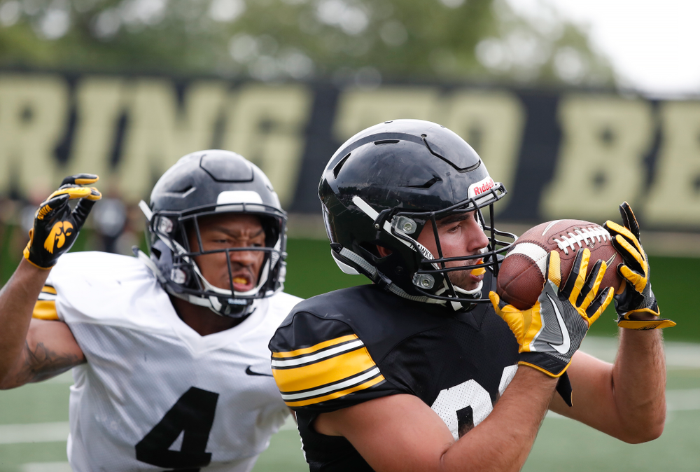 Iowa Hawkeyes wide receiver Nico Ragaini (89) and defensive back Josh Turner (4) during practice No. 4 of Fall Camp Monday, August 6, 2018 at the Hansen Football Performance Center. (Brian Ray/hawkeyesports.com)