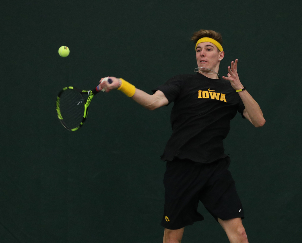 Iowa's Nikita Snezhko against UMKC Friday, February 15, 2019 at the Hawkeye Tennis and Recreation Complex. (Brian Ray/hawkeyesports.com)