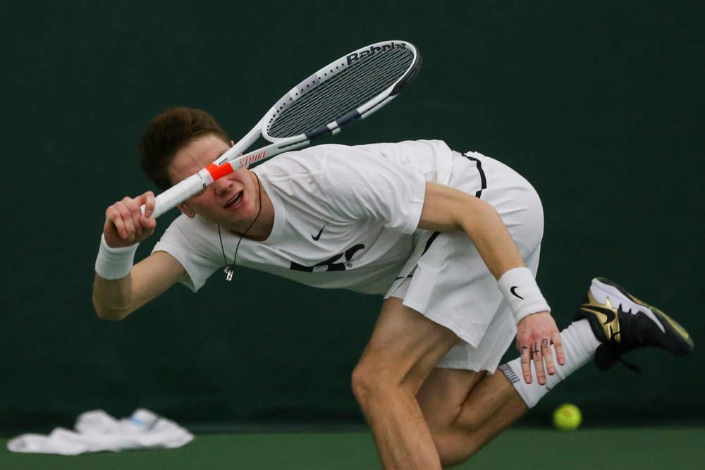 Iowa's Jason Kerst dives to hit a forehand during the Iowa men's tennis match vs Western Michigan on Saturday, January 18, 2020 at the Hawkeye Tennis and Recreation Complex. (Lily Smith/hawkeyesports.com)