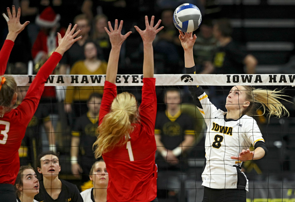 Iowa's Kyndra Hansen (8) sends the ball over for a kill during the fourth set of their match at Carver-Hawkeye Arena in Iowa City on Saturday, Nov 30, 2019. (Stephen Mally/hawkeyesports.com)