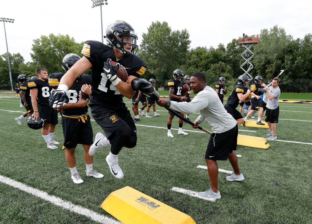 Iowa Hawkeyes wide receiver Kyle Groeneweg (14) and running backs coach Derrick Foster during practice No. 4 of Fall Camp Monday, August 6, 2018 at the Hansen Football Performance Center. (Brian Ray/hawkeyesports.com)