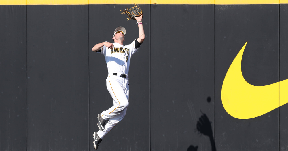 Iowa Hawkeyes outfielder Ben Norman (9) makes a catch in right field against the Nebraska Cornhuskers Saturday, April 20, 2019 at Duane Banks Field. (Brian Ray/hawkeyesports.com)