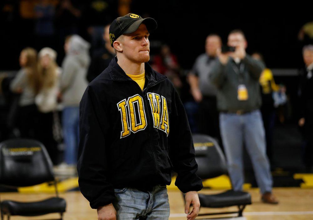 Iowa senior Phillip Laux is recognized following their meet against Northwestern