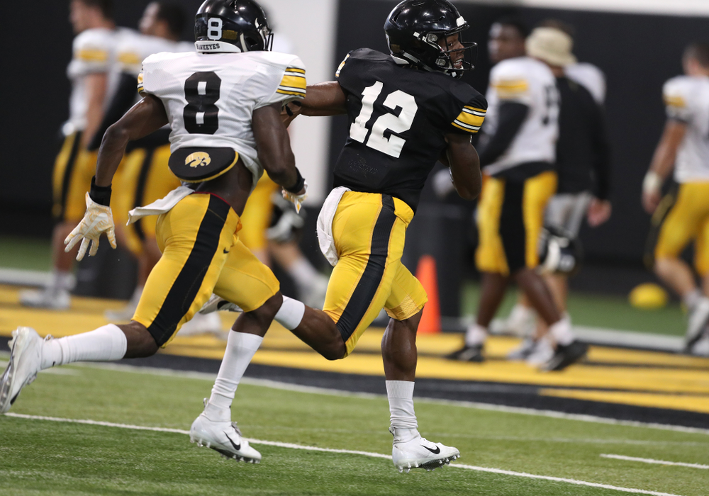 Iowa Hawkeyes wide receiver Brandon Smith (12) during Fall Camp Practice No. 6 Thursday, August 8, 2019 at the Ronald D. and Margaret L. Kenyon Football Practice Facility. (Brian Ray/hawkeyesports.com)
