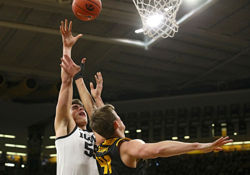 Iowa Hawkeyes center Luka Garza (55) scores a basket during the first half of their their game at Carver-Hawkeye Arena in Iowa City on Sunday, December 29, 2019. (Stephen Mally/hawkeyesports.com)