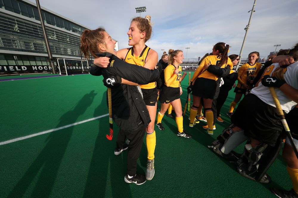 Iowa Hawkeyes Ellie Holley (7) hugs Grace McGuire (62) following their game against the Michigan Wolverines in the semi-finals of the Big Ten Tournament Friday, November 2, 2018 at Lakeside Field on the campus of Northwestern University in Evanston, Ill. (Brian Ray/hawkeyesports.com)
