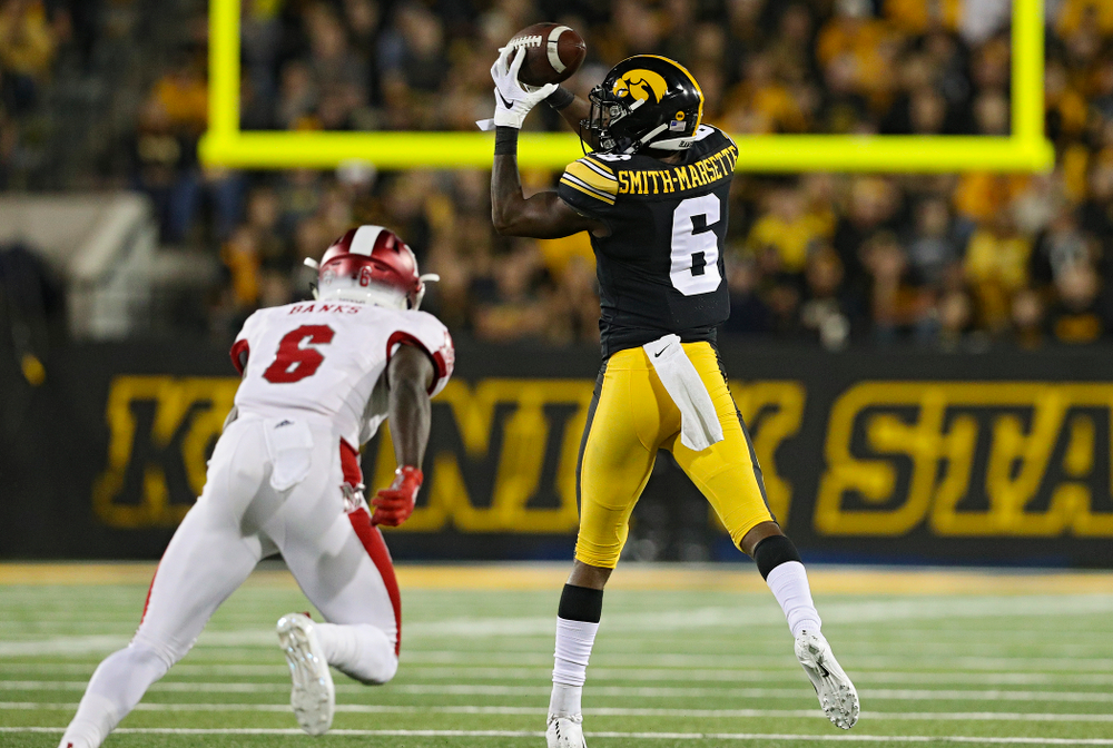 Iowa Hawkeyes wide receiver Ihmir Smith-Marsette (6) pulls in a pass during the third quarter of their game at Kinnick Stadium in Iowa City on Saturday, Aug 31, 2019. (Stephen Mally/hawkeyesports.com)