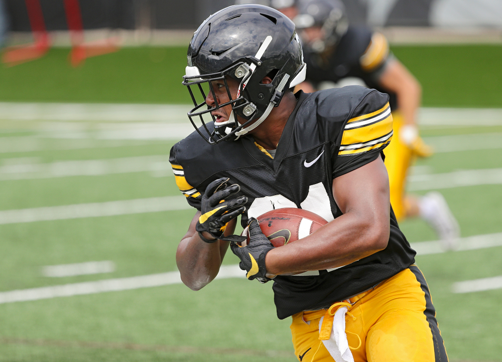 Iowa Hawkeyes running back Ivory Kelly-Martin (21) runs after pulling in a pass during Fall Camp Practice No. 10 at the Hansen Football Performance Center in Iowa City on Tuesday, Aug 13, 2019. (Stephen Mally/hawkeyesports.com)