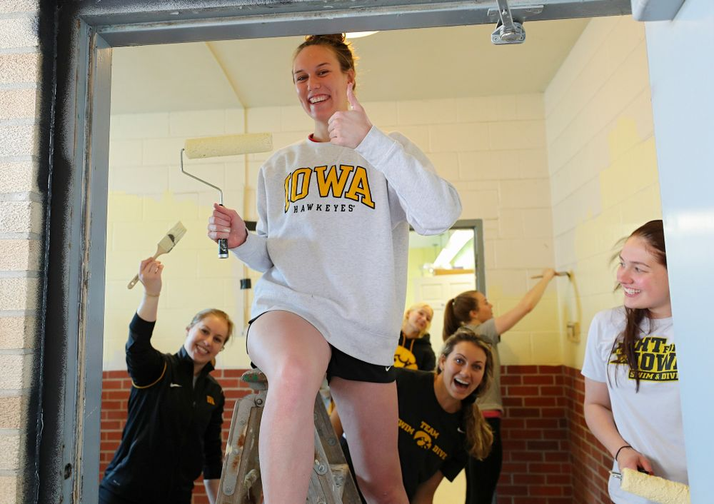 Iowa women's swimming and diving teammates paint a room at the Coralville Community Food Pantry during the 21st annual ISAAC Hawkeye Day of Caring in Coralville on Sunday, Apr. 28, 2019. (Stephen Mally/hawkeyesports.com)