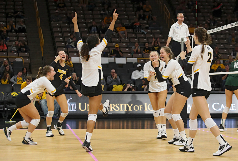 Iowa's Joslyn Boyer (1), Halle Johnston (4), Brie Orr (7), Kyndra Hansen (8), Blythe Rients (11), and Courtney Buzzerio (2) celebrate a score during the third set of their volleyball match at Carver-Hawkeye Arena in Iowa City on Sunday, Oct 13, 2019. (Stephen Mally/hawkeyesports.com)
