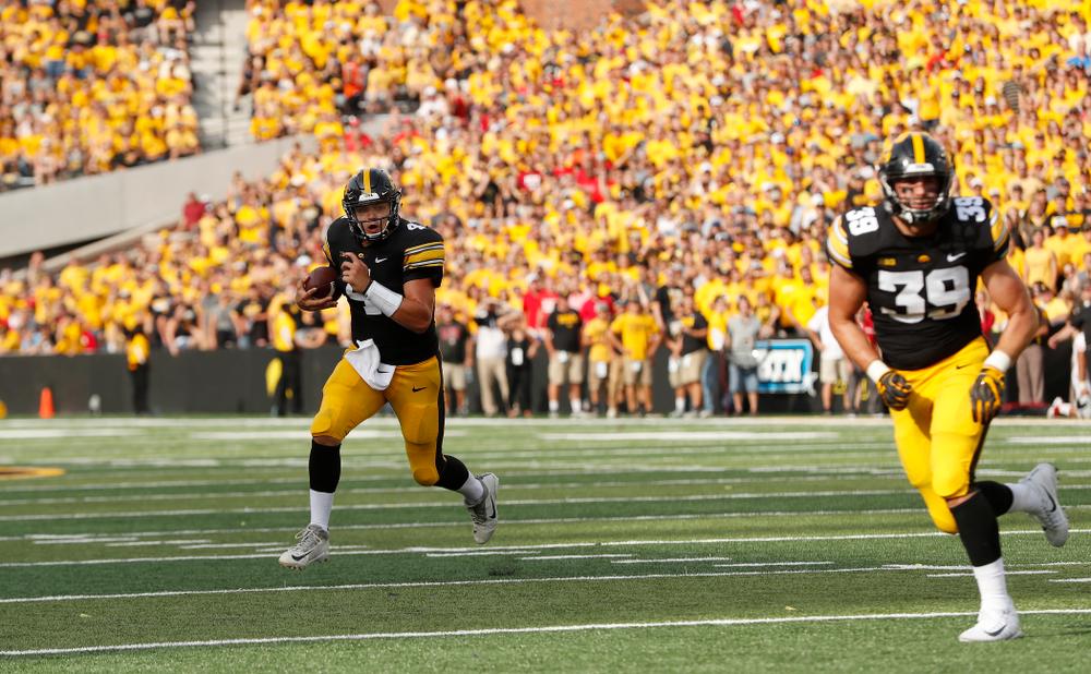 Iowa Hawkeyes quarterback Nate Stanley (4) carries the ball against the Northern Illinois Huskies Saturday, September 1, 2018 at Kinnick Stadium. (Brian Ray/hawkeyesports.com)