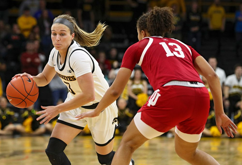Iowa Hawkeyes guard Makenzie Meyer (3) drives in on Indiana Hoosiers guard Jaelynn Penn (13) during the second overtime period of their game at Carver-Hawkeye Arena in Iowa City on Sunday, January 12, 2020. (Stephen Mally/hawkeyesports.com)