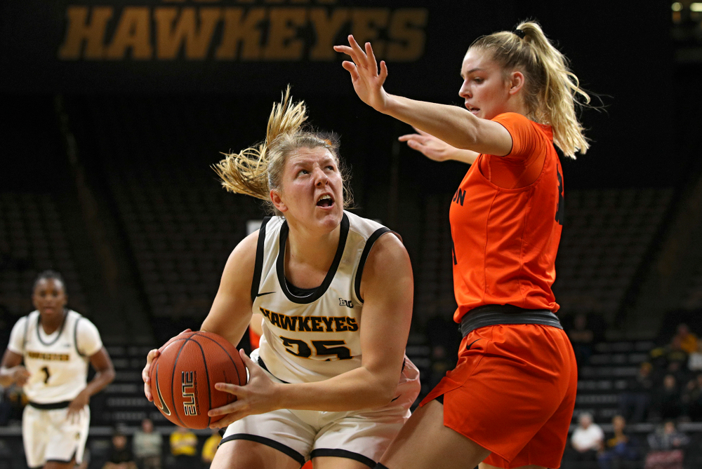 Iowa forward/center Monika Czinano (25) eyes the basket during the first quarter of their overtime win against Princeton at Carver-Hawkeye Arena in Iowa City on Wednesday, Nov 20, 2019. (Stephen Mally/hawkeyesports.com)