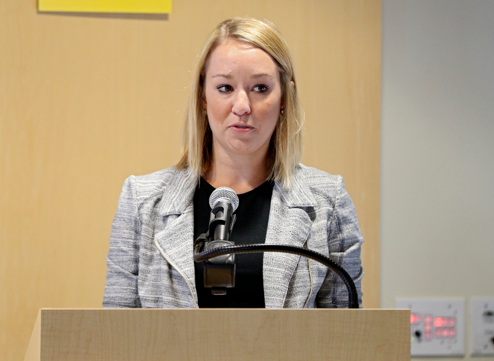 Monica Nieves, Vice President of Special Events and Communications for the Iowa City/Coralville Area Convention and Visitors Bureau, speaks during the press conference to discuss FryFEST and announce the 2019 Iowa Athletics Hall of Fame members in the Varsity Club Room at the University of Iowa Athletics Hall of Fame in Iowa City on Tuesday, Jun 11, 2019. (Stephen Mally/hawkeyesports.com)