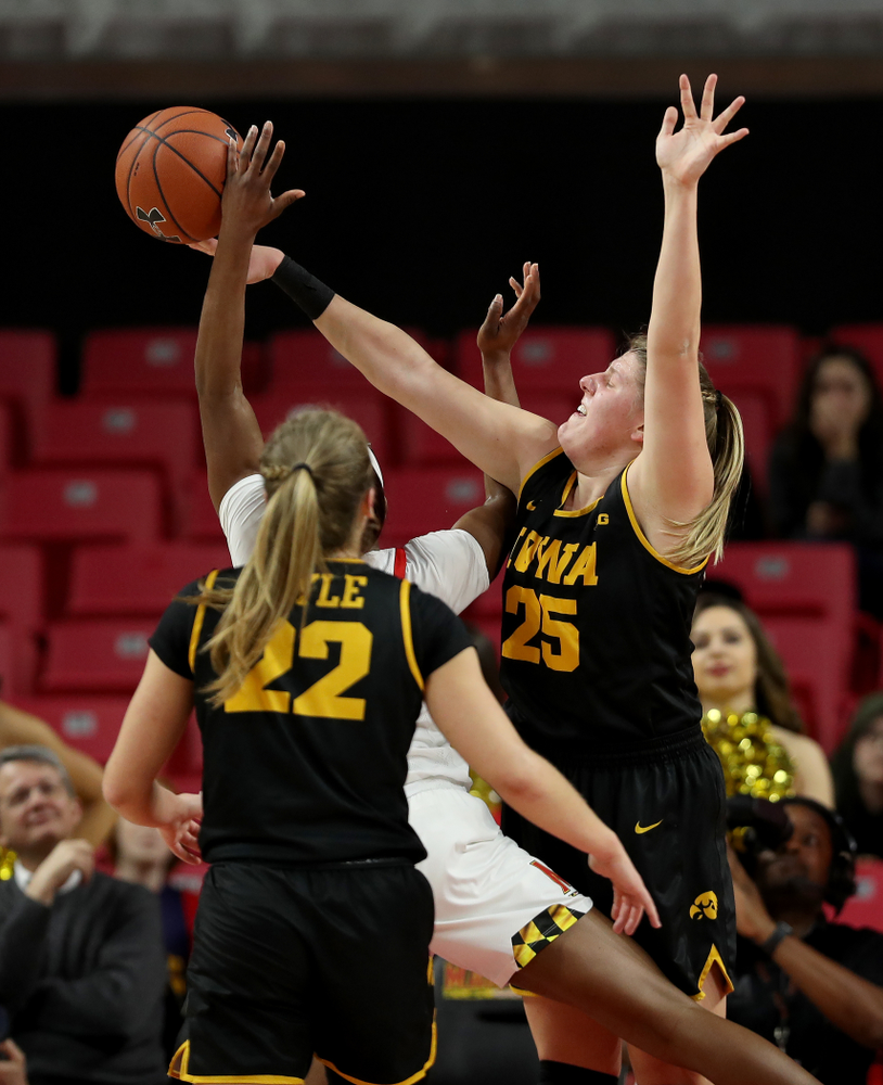 Iowa Hawkeyes forward/center Monika Czinano (25) blocks a shot against the Maryland Terrapins Thursday, February 13, 2020 at the Xfinity Center in College Park, MD. (Brian Ray/hawkeyesports.com)
