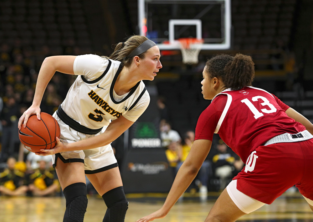 Iowa Hawkeyes guard Makenzie Meyer (3) keeps the ball away from Indiana Hoosiers guard Jaelynn Penn (13) during the fourth quarter of their game at Carver-Hawkeye Arena in Iowa City on Sunday, January 12, 2020. (Stephen Mally/hawkeyesports.com)