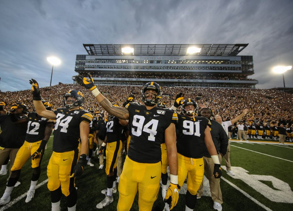 Iowa Hawkeyes defensive end A.J. Epenesa (94) waves to the Stead Family ChildrenÕs Hospital during their game against the Miami RedHawks Saturday, August 31, 2019 at Kinnick Stadium in Iowa City. (Brian Ray/hawkeyesports.com)