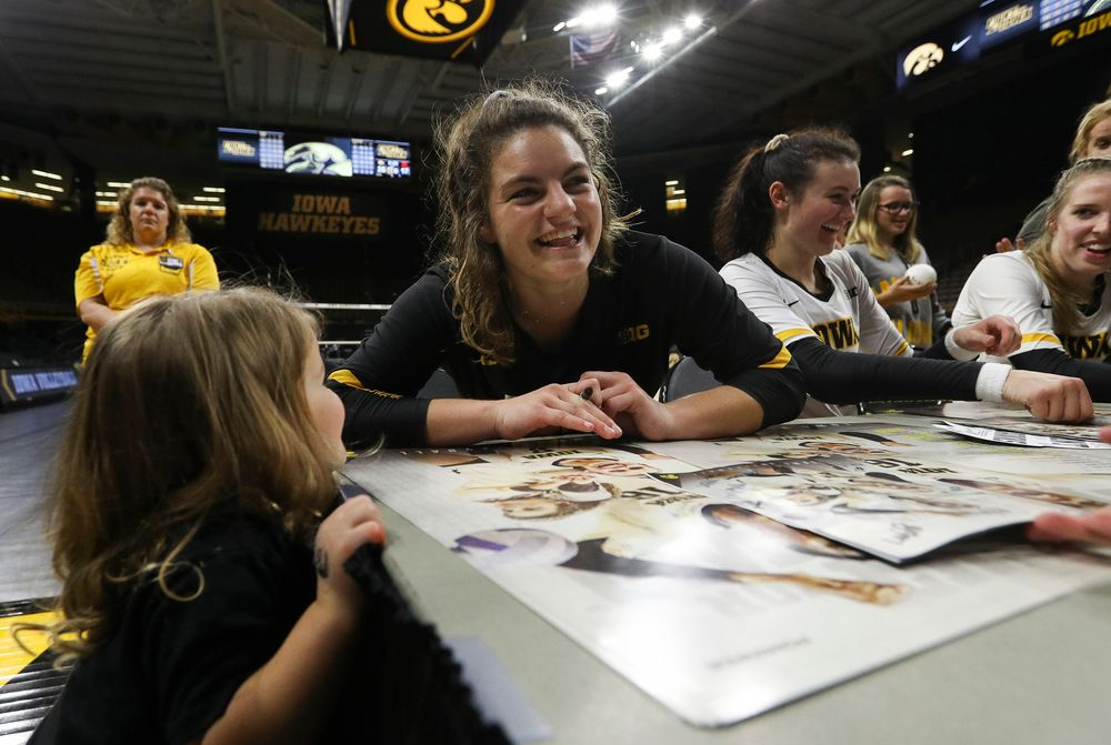 Iowa Hawkeyes defensive specialist Molly Kelly (1) signs an autograph for a young fan after a match against Rutgers at Carver-Hawkeye Arena on November 2, 2018. (Tork Mason/hawkeyesports.com)