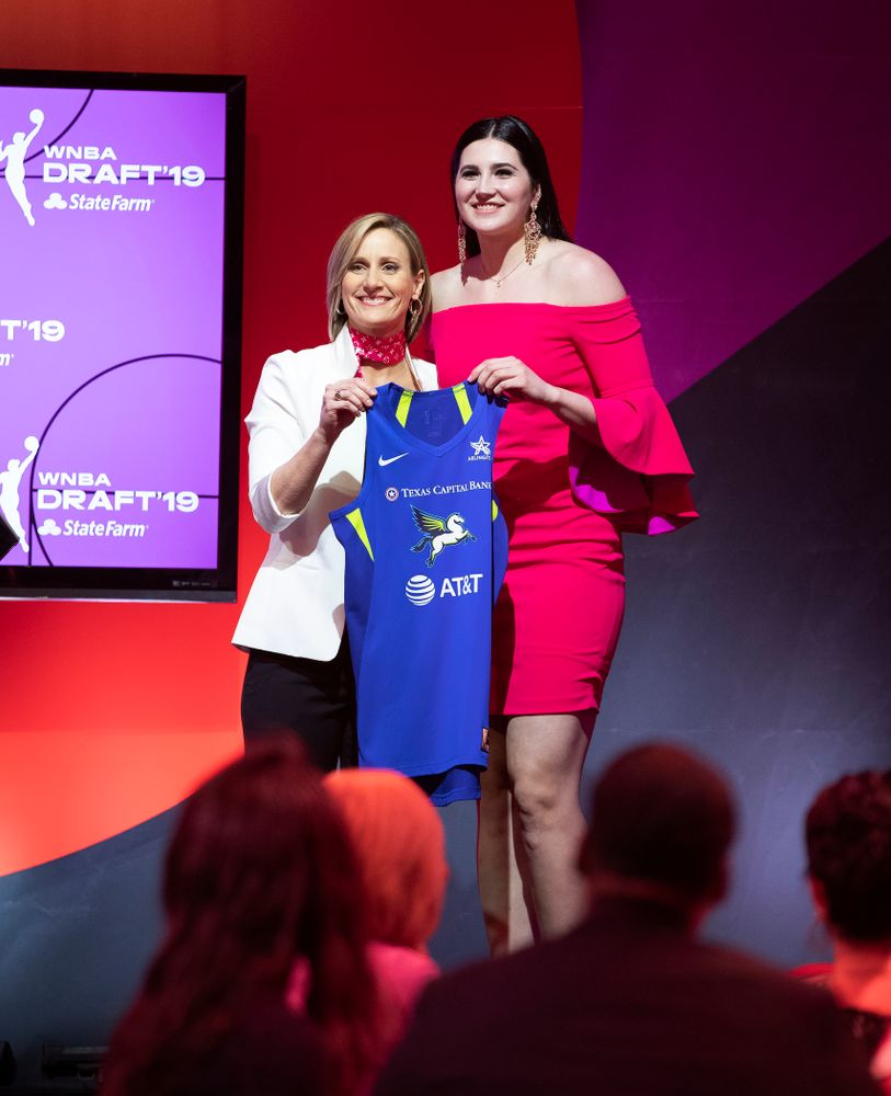 Iowa Hawkeyes forward Megan Gustafson (10) holds up a jersey after being selected by the Dallas Wings in the second round of the 2019 WNBA Draft Wednesday, April 10, 2019 at Nike New York Headquarters in New York City. (Brian Ray/hawkeyesports.com)