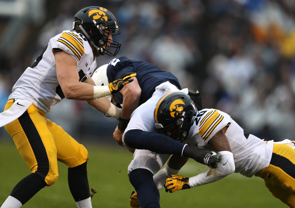 Iowa Hawkeyes defensive back Jake Gervase (30) and defensive back Julius Brents (20) against the Penn State Nittany Lions Saturday, October 27, 2018 at Beaver Stadium in University Park, Pa. (Brian Ray/hawkeyesports.com)