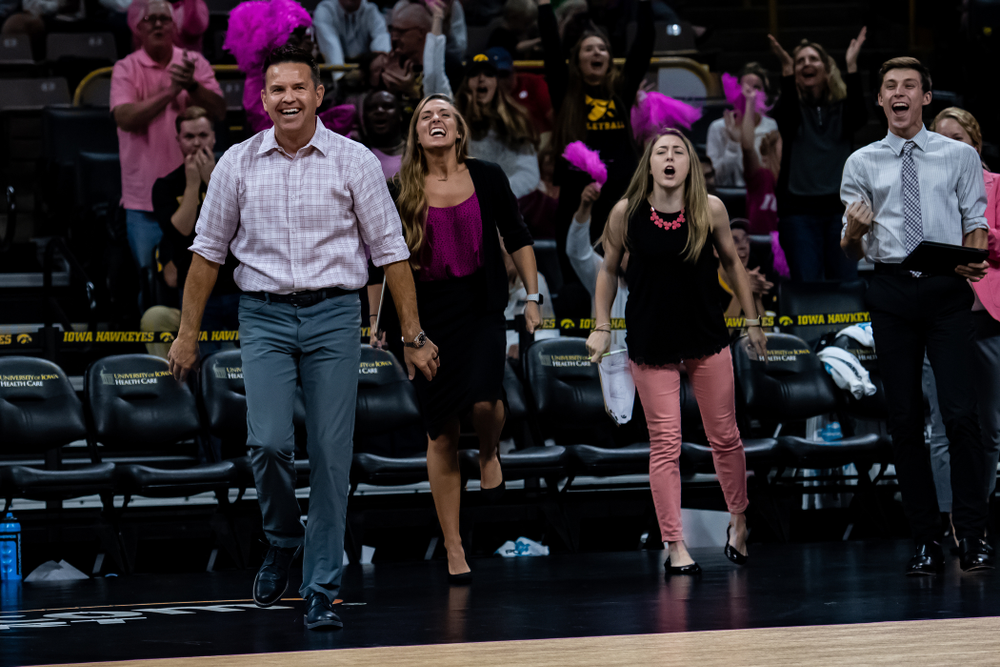 Iowa Hawkeyes head coach Bond Shymansky and director of volleyball operations Emily Sparks against the Wisconsin Badgers Saturday, October 6, 2018 at Carver-Hawkeye Arena. (Clem Messerli/Iowa Sports Pictures)