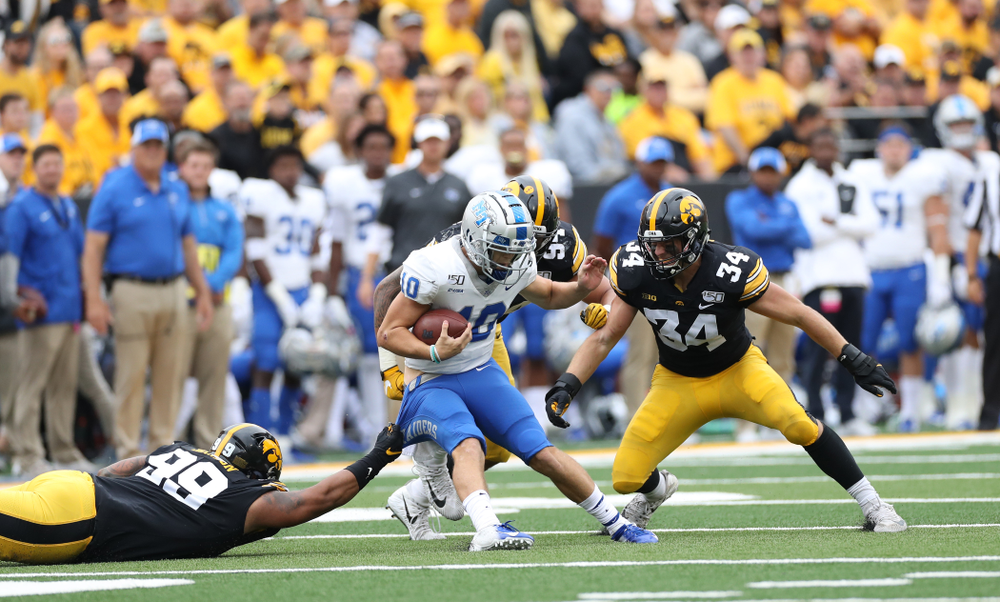 Iowa Hawkeyes defensive lineman Noah Shannon (99) and linebacker Kristian Welch (34) against Middle Tennessee State Saturday, September 28, 2019 at Kinnick Stadium. (Max Allen/hawkeyesports.com)