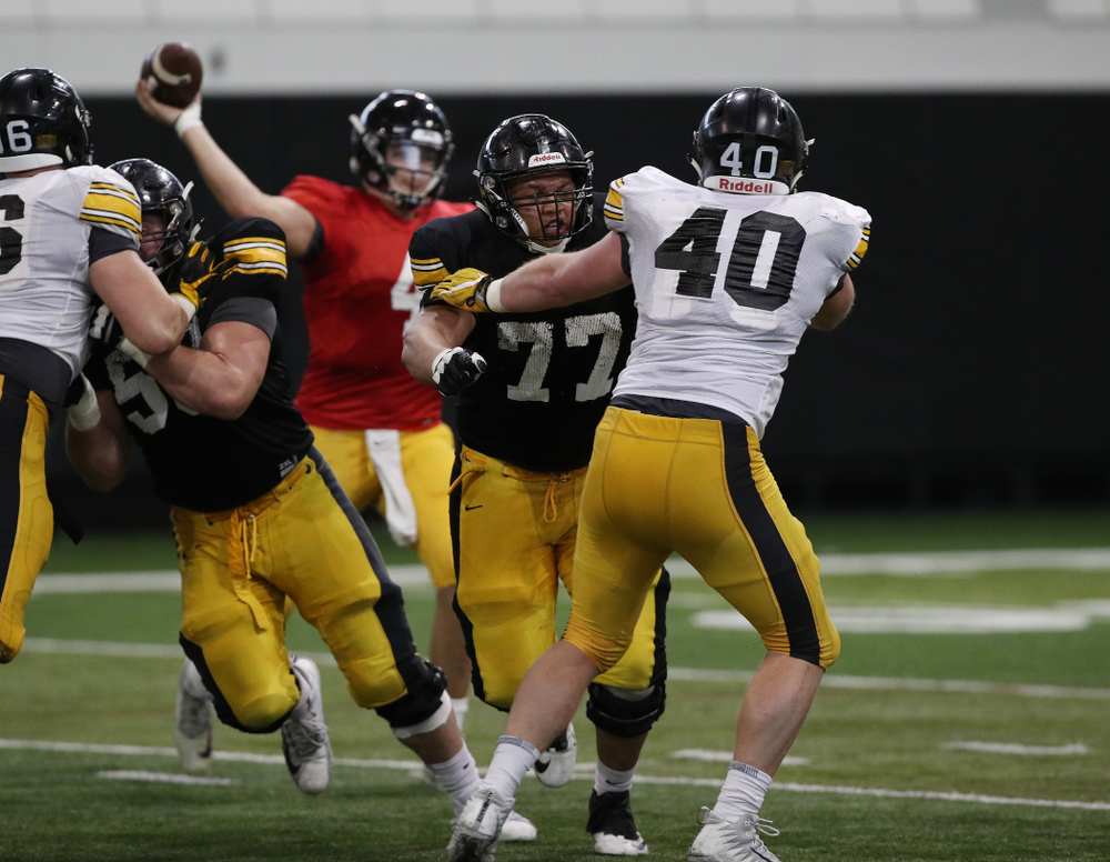 Iowa Hawkeyes offensive lineman Alaric Jackson (77) and defensive end Parker Hesse (40) during preparation for the 2019 Outback Bowl Wednesday, December 19, 2018 at the Hansen Football Performance Center. (Brian Ray/hawkeyesports.com)
