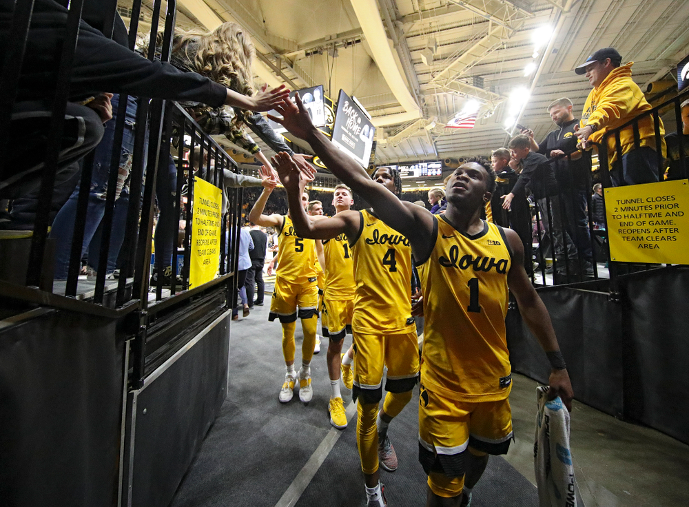 Iowa Hawkeyes guard Joe Toussaint (1), guard Bakari Evelyn (4), guard Austin Ash (13), and guard CJ Fredrick (5) greet fans after winning their game at Carver-Hawkeye Arena in Iowa City on Saturday, February 8, 2020. (Stephen Mally/hawkeyesports.com)
