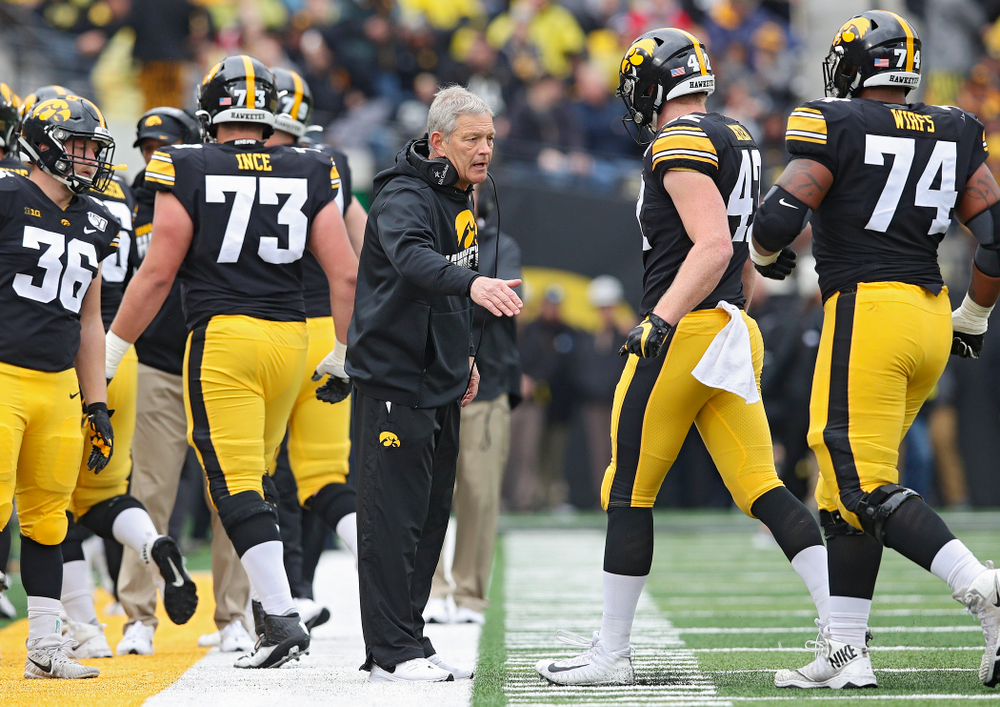 Iowa Hawkeyes head coach Kirk Ferentz greets tight end Shaun Beyer (42) during the first quarter of their game at Kinnick Stadium in Iowa City on Saturday, Oct 19, 2019. (Stephen Mally/hawkeyesports.com)