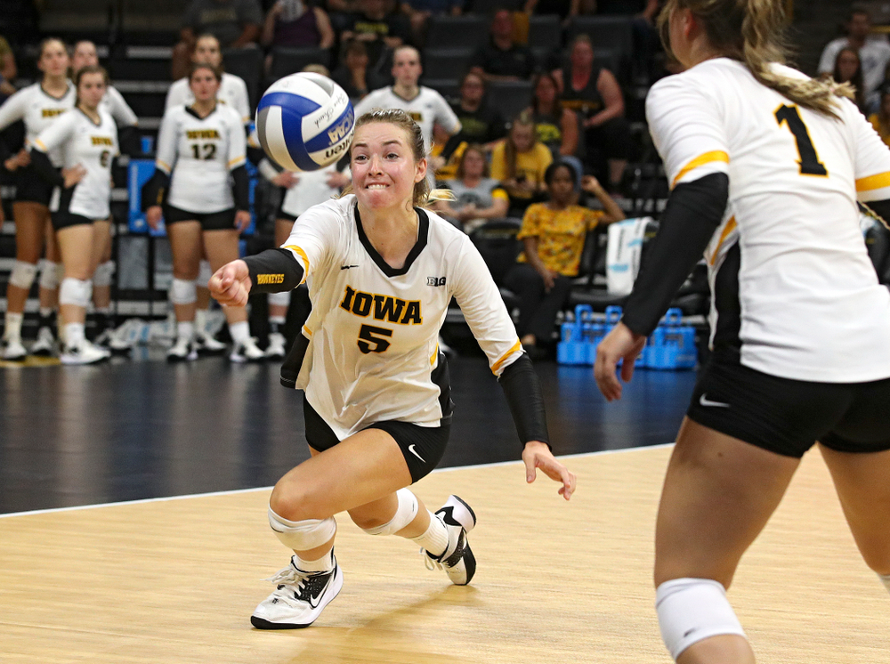 Iowa's Meghan Buzzerio (5) eyes the ball as Joslyn Boyer (1) looks on during their Big Ten/Pac-12 Challenge match at Carver-Hawkeye Arena in Iowa City on Saturday, Sep 7, 2019. (Stephen Mally/hawkeyesports.com)