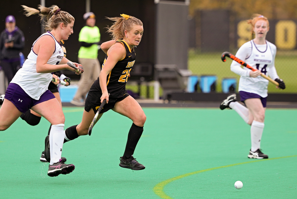 Iowa's Maddy Murphy (26) runs down the ball before scoring a goal during the fourth quarter of their game at Grant Field in Iowa City on Saturday, Oct 26, 2019. (Stephen Mally/hawkeyesports.com)