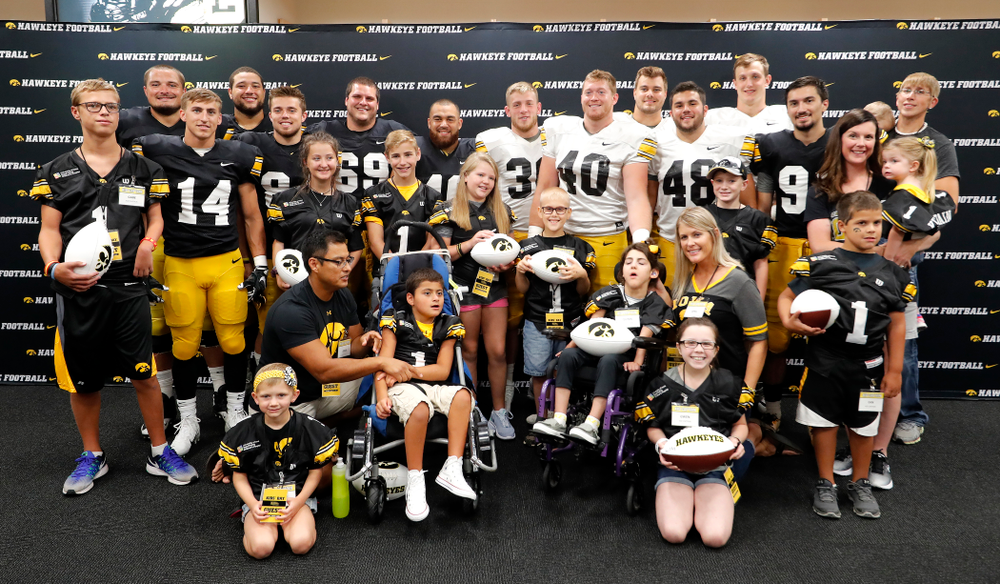 The Hawkeye Football Seniors with the Kids Captains during Kids Day Saturday, August 11, 2018 at Kinnick Stadium. (Brian Ray/hawkeyesports.com)