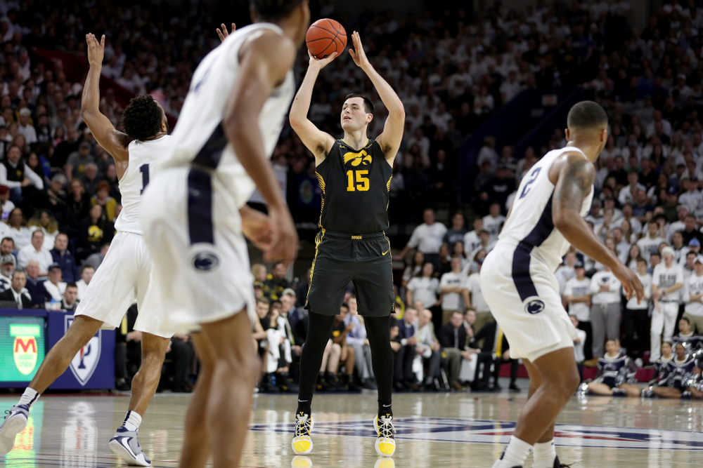Iowa Hawkeyes forward Ryan Kriener (15) pulls up for a shot against Penn State Friday, January 3, 2020 at the Palestra in Philadelphia. (Brian Ray/hawkeyesports.com)