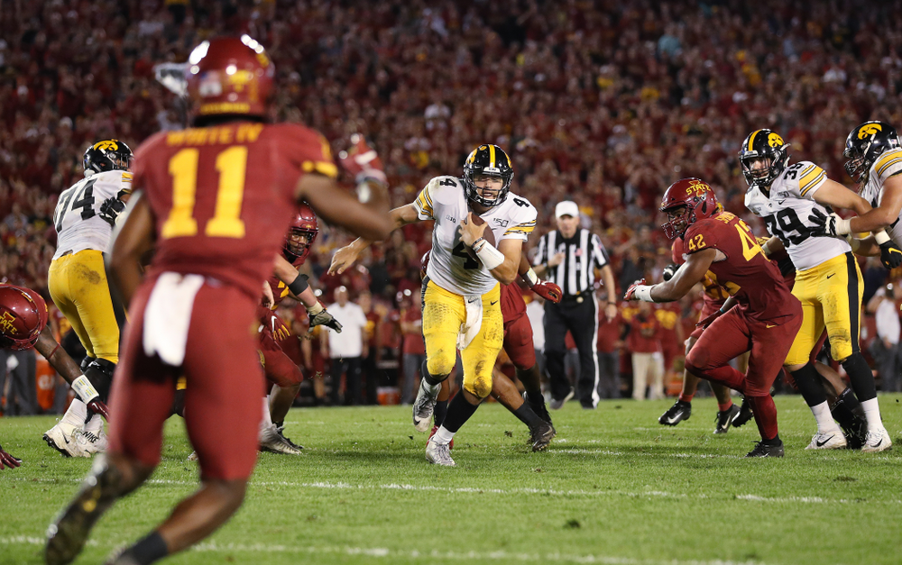Iowa Hawkeyes quarterback Nate Stanley (4) picks up a first down against the Iowa State Cyclones Saturday, September 14, 2019 in Ames, Iowa. (Brian Ray/hawkeyesports.com)